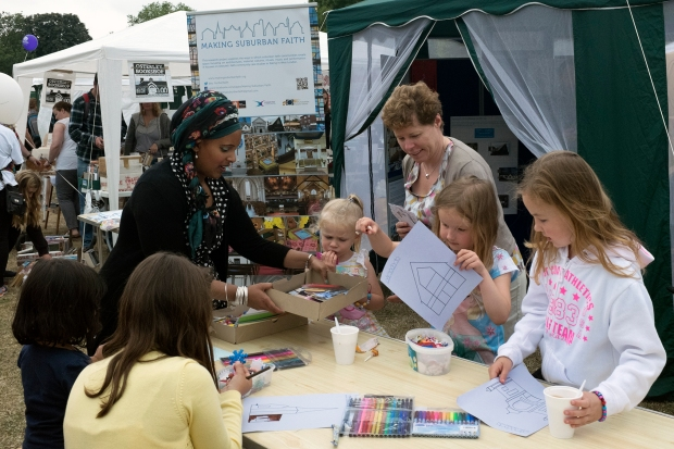 Children busy colouring and decorating at the MSF stall with Dr. Claire Dwyer and Dr. Nazneen Ahmed. Photo: Liz Hingley