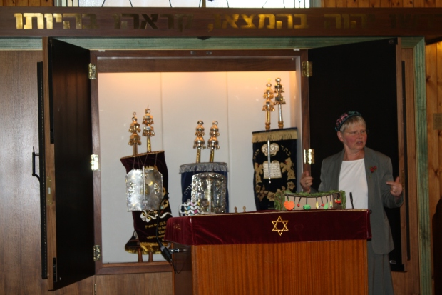 Rabbi Janet Burden and Torah scrolls